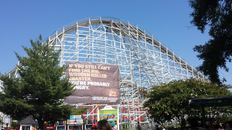 Snickers ad on the side of a wooden roller coaster