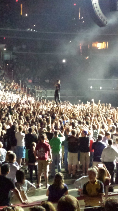 Here's Matt Shultz standing on the crowd while crowdsurfing