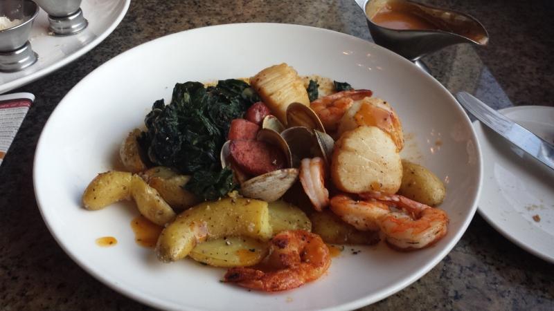 Seafood étoufée from Simon & Seafort's in Juneau, Alaska, featuring some chunks of REINDEER SAUSAGE