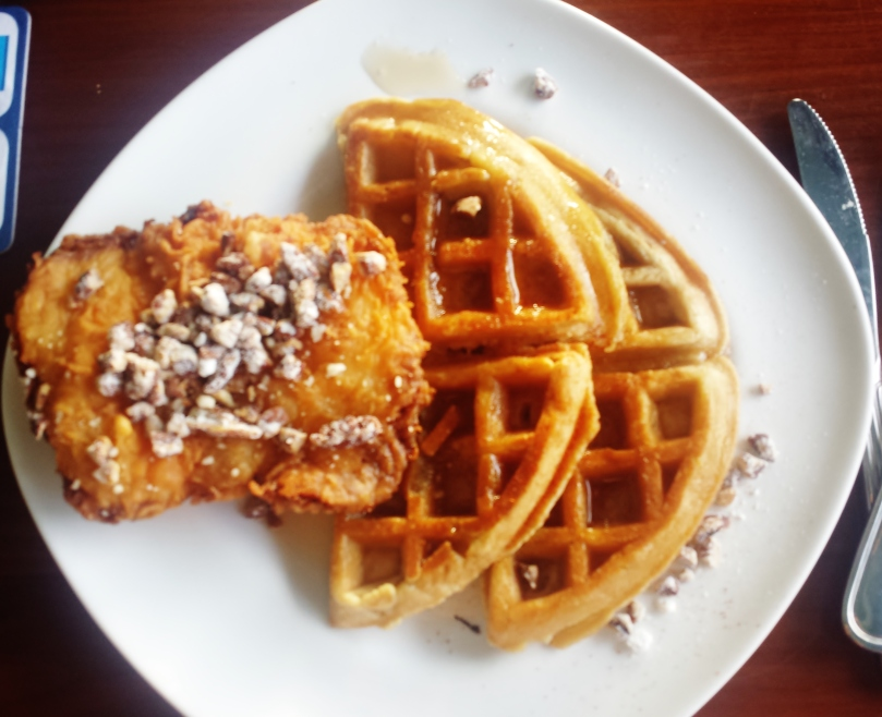 Chicken and waffles with candied pecans and cayenne maple syrup