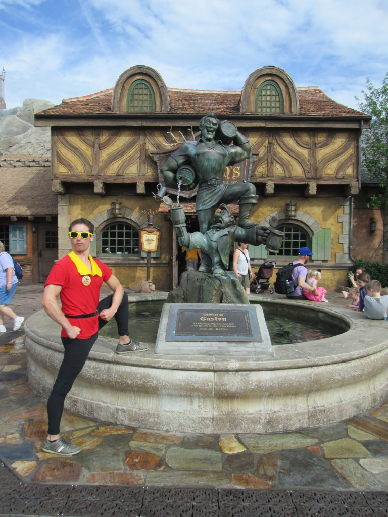 Tim as Gaston, posing with the Gaston fountain