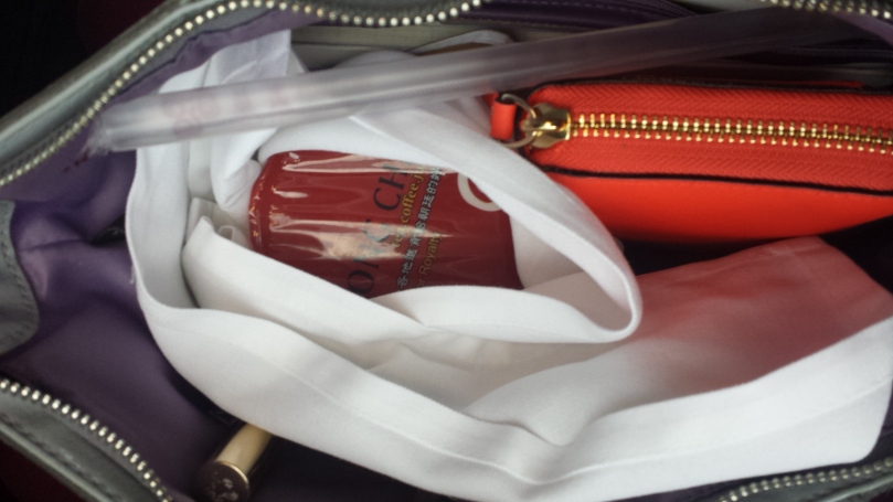 Packed carefully into my purse for the road home... and it made it! (Until it promptly spilled when I walked through my front door....... typical...)