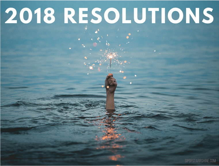 2018 Resolutions: photo featuring a hand holding a sparkler above water